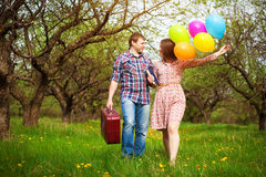 Happy loving couple on a spring meadow Stock Image
