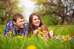 Happy loving couple on a spring meadow Royalty Free Stock Image