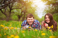 Happy loving couple on a spring meadow Royalty Free Stock Images