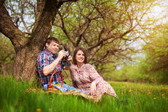 Happy loving couple on a spring meadow stock photo