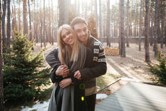 Happy loving couple standing outdoors in the forest Royalty Free Stock Images