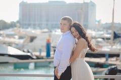 Happy loving couple on sunny marina outdoors background Stock Photos