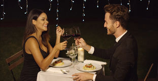 Happy loving couple toasting each other Stock Image