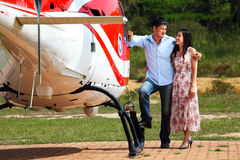 Happy loving couple traveling by helicopter Royalty Free Stock Photos
