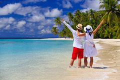 Happy loving couple on tropical beach Stock Photos