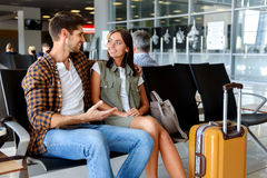 Happy loving couple waiting for flight Stock Photography