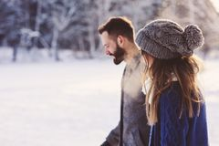 Free Happy Loving Couple Walking In Snowy Winter Forest, Spending Christmas Vacation Together. Outdoor Seasonal Activities Royalty Free Stock Photos - 100241128