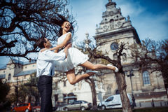 Happy and loving couple walking and make photo in the old city Stock Photos