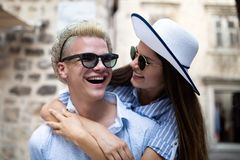 Happy loving couple. Happy young man piggybacking his girlfriend. Happy loving couple. Happy young men piggybacking his girlfriend while having fun royalty free stock images