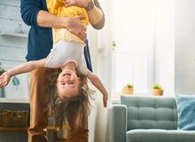 Daddy and daughter playing together. Happy loving family. Daddy and his daughter child girl playing together. Father`s day concept royalty free stock photos
