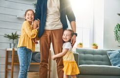 Happy father`s day. Happy loving family. Daddy and his daughters children girls playing together. Father`s day concept stock photography