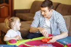 Happy loving family. Father and daughter play and have fun together. stock photos