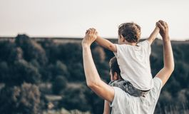 Loving family. Father and his son baby boy playing and hugging outdoors. Happy dad and son outdoors. Concept of Father`s day. Happy loving family. Father and royalty free stock images