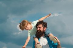 Happy loving family - Father and son. Dream of flying. Happy family father and child on meadow with a kite in the summer stock photos