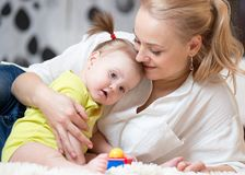 Happy loving family. Mom and her daughter baby playing and hugging. stock photography