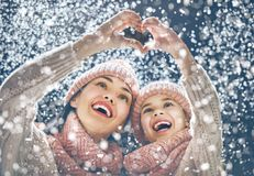 Family playing on winter walk. Happy loving family! Mother and child girl having fun, playing and laughing on snowy winter walk in nature. Frost winter season Stock Images