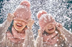 Family playing on winter walk. Happy loving family! Mother and child girl having fun, playing and laughing on snowy winter walk in nature. Frost winter season Royalty Free Stock Photography