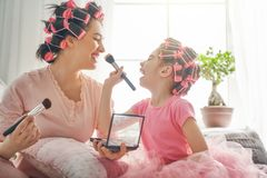 Mom and child doing makeup Royalty Free Stock Image
