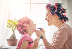 Mom and child doing makeup Royalty Free Stock Photography