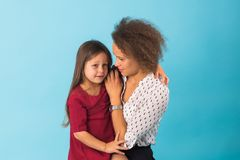 Happy loving family. Mother and daughter playing, kissing and hugging royalty free stock photo