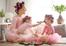 Mom and children doing makeup stock images