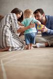 Happy loving family. mother and father playing with her baby at royalty free stock photography