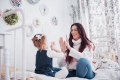 Happy loving family. Mother and her daughter child girl playing royalty free stock images