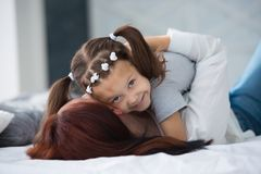 Happy loving family. Mother and her daughter child girl playing and hugging royalty free stock photo