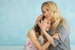Happy loving family. Mother and her daughter child girl playing and hugging. royalty free stock photo