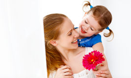 Happy loving family. mothers Day. daughter gives her mother flow Stock Images