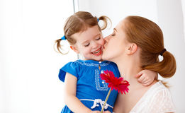 Happy loving family. mothers Day. daughter gives her mother flow Stock Photos