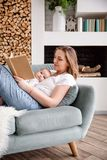 Happy loving family. Pretty young mother reading a book to her daughter royalty free stock images