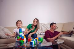 Happy loving family. Smiling parents playing with her daughter stock photo
