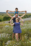 Happy loving family spends a weekend in nature Royalty Free Stock Photography