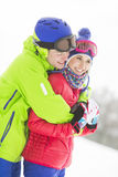 Happy loving man hugging woman in snow Stock Image