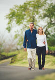Happy loving middle aged couple walking Royalty Free Stock Images
