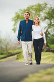 Happy loving middle aged couple walking Stock Images