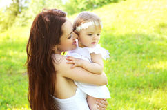 Happy loving mom and baby together outdoor stock image