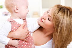 Happy loving mother with baby Stock Photography