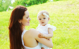 Happy loving mother and baby together outdoors royalty free stock image