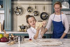 Mother, daughter, girl, prepare bakery, Home cooking stock photo