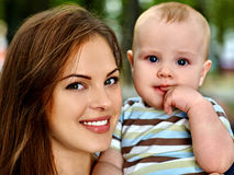 Happy loving mother and her baby outdoors Stock Photo