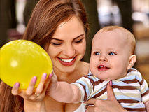Happy loving mother plying with her baby outdoors Stock Photo