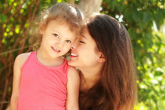Happy loving mother and smiling kid girl Stock Image