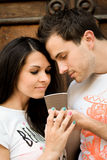 Happy loving pretty young couple outdoors Stock Photography