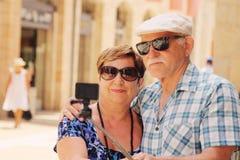 Happy loving senior couple enjoying vacation Stock Photography