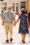 Happy loving senior couple enjoying vacation Stock Photos