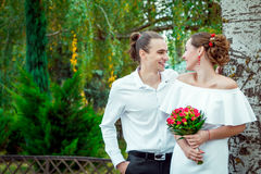 Happy loving wedding couple hugging in the autumn park Royalty Free Stock Image