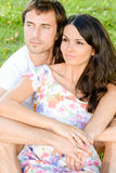 Happy loving young couple outdoors relaxing royalty free stock images