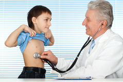 Happy luck Caucasian doctor with patients Stock Images